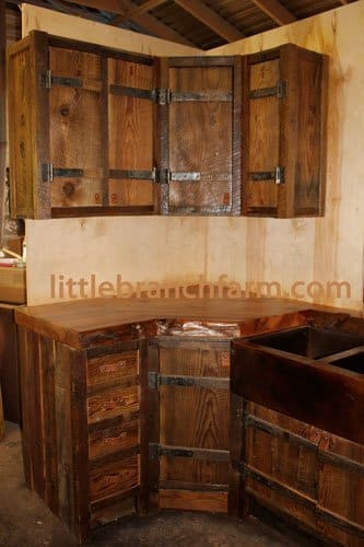 Barn wood cabinets that feature hand forged hinges and for Barn style kitchen cabinets