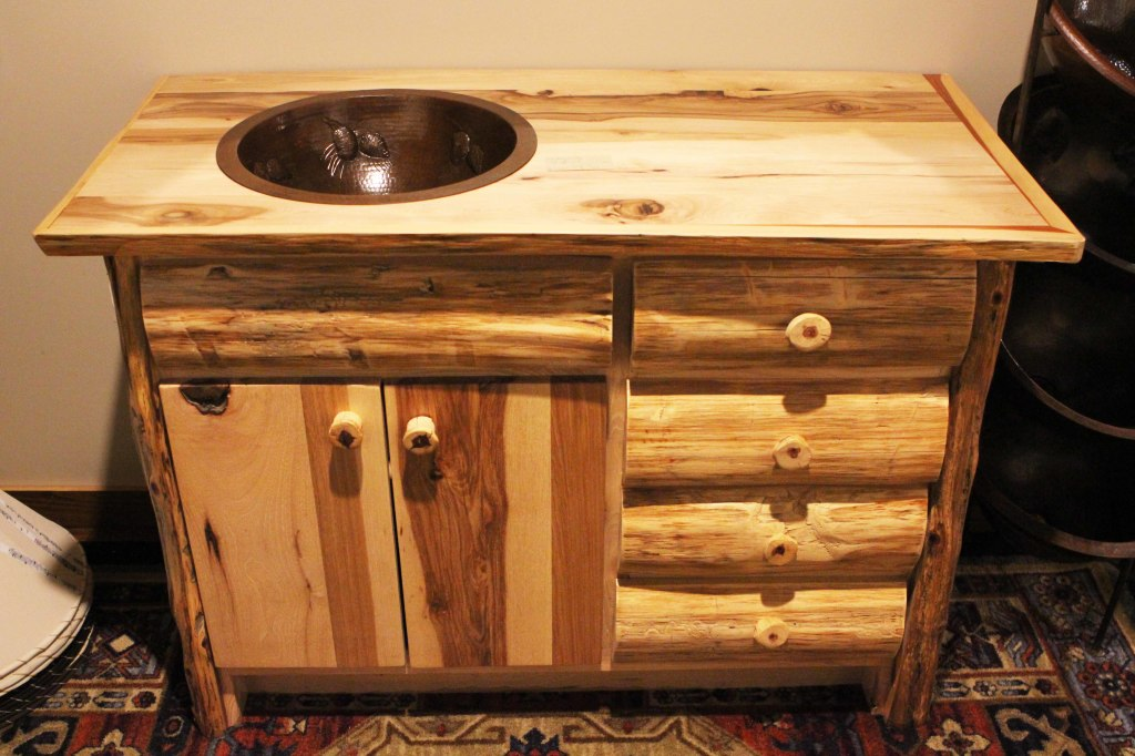 "Natural hickory lumber and eastern cedar logs are combined to make this rustic bathroom vanity. This is a solid wood vanity with full extension ball bearing glides and solid wood drawers. This vanity is 48""w 24""d x 35""h. ON SALE $1,400. Click Here to Order: Vanity 06"