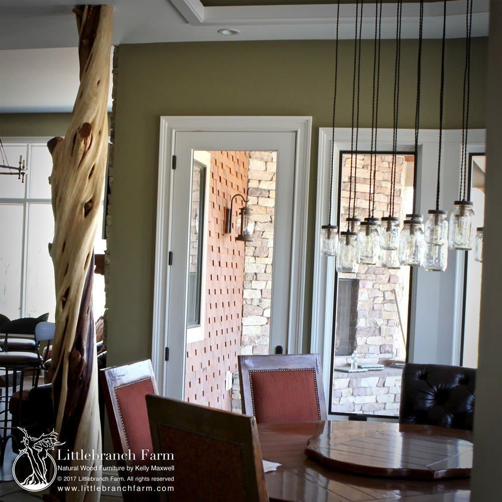 Twisted Juniper log column shown in a contemporary rustic home.