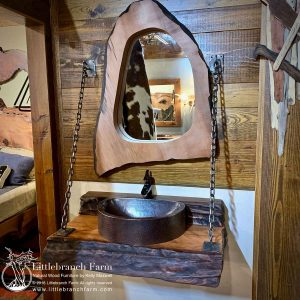 Live edge wood vanity with copper vessel sink