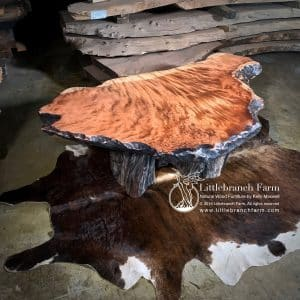 live edge wood coffee tables on cowhide