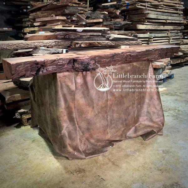 Rustic redwood fireplace mantel