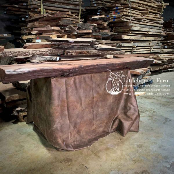 Redwood rustic wood fireplace mantel with live edge