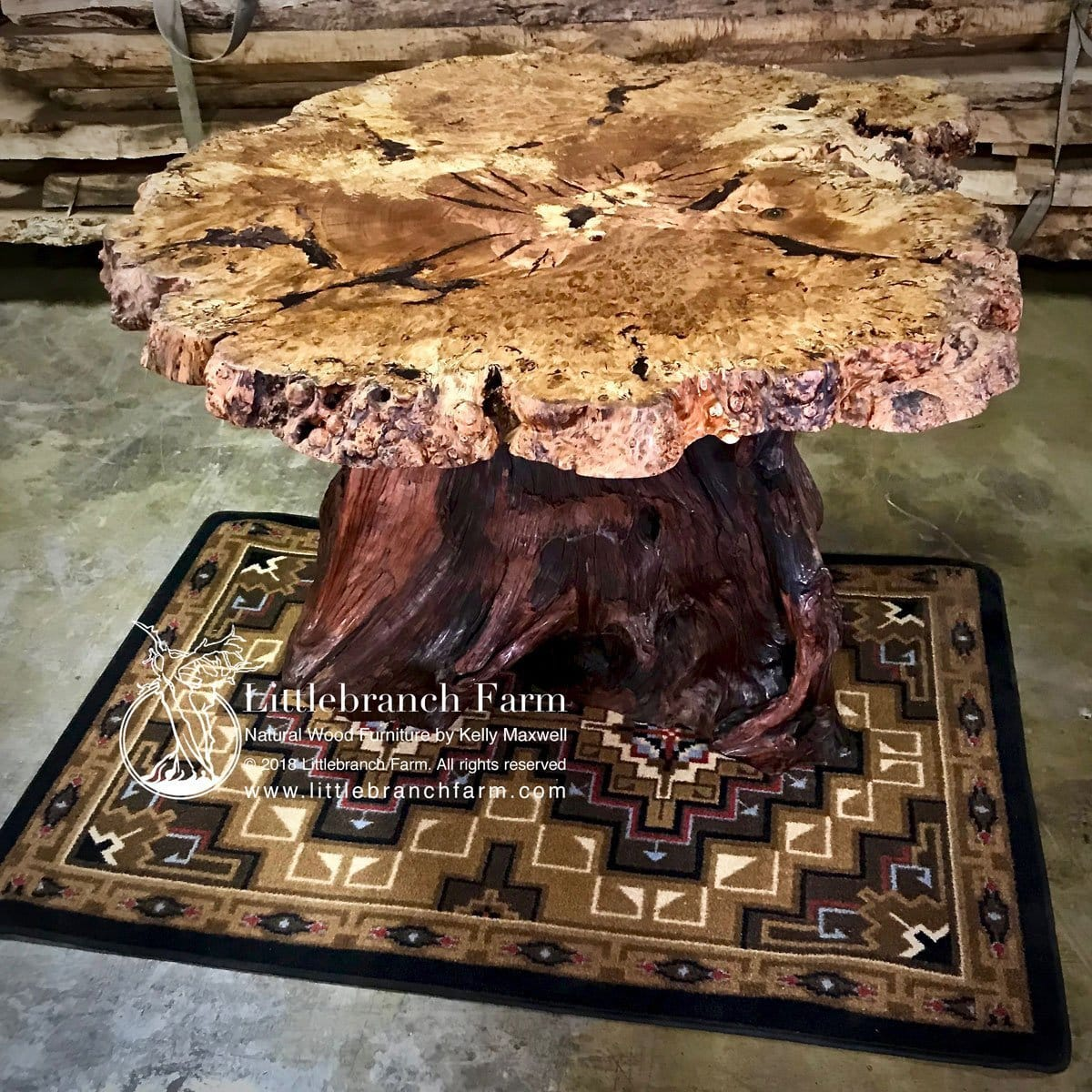 Black oak burl wood dining table with tree stump base.