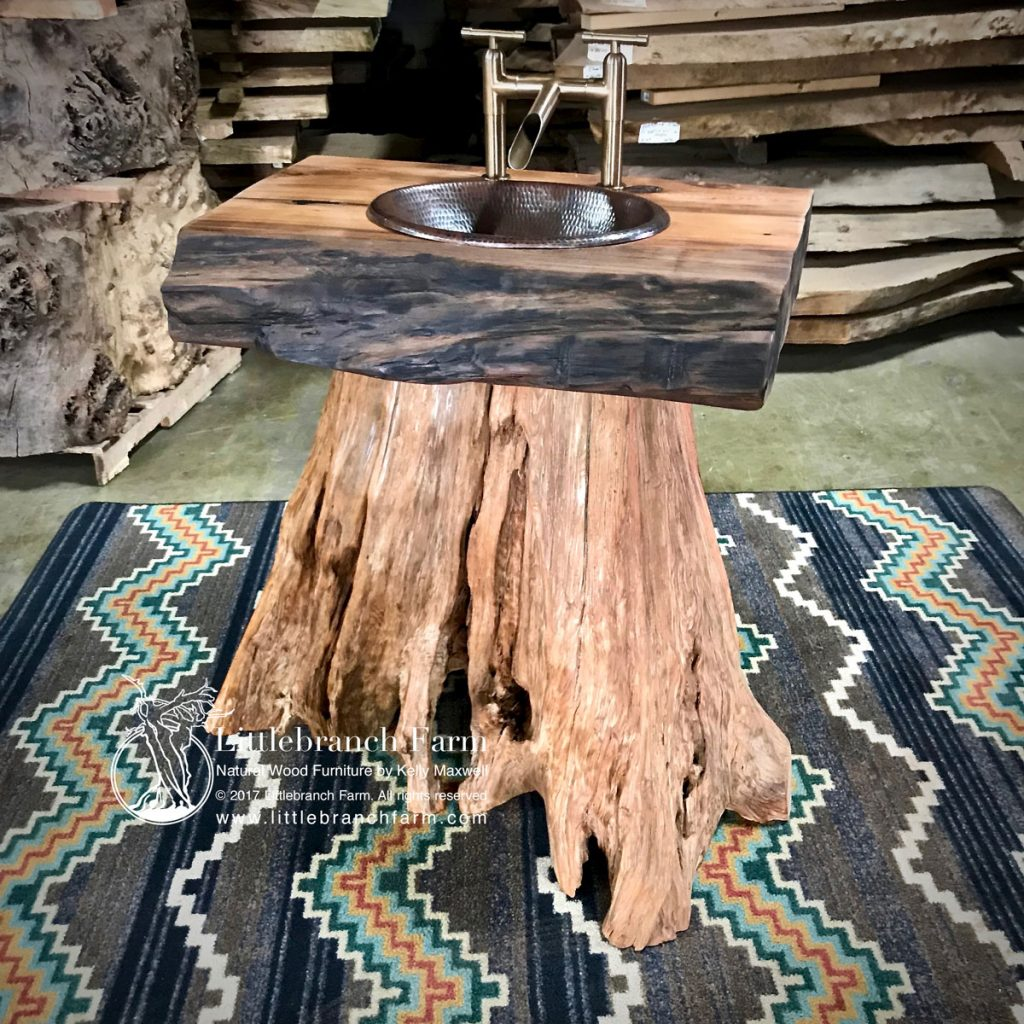 Tree stump sink with Sanoma forge faucet.