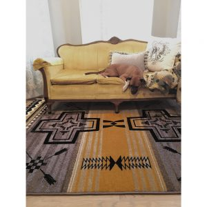 Gold and gray rug in room
