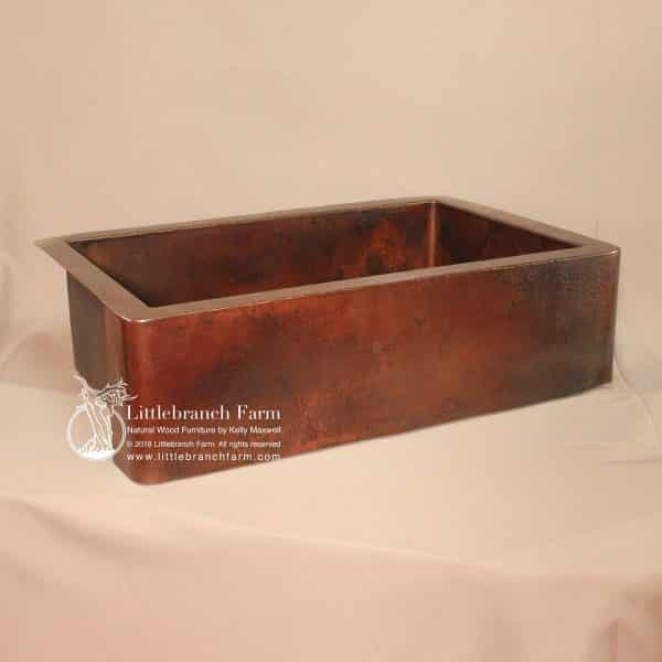 Farmhouse kitchen sink made from copper.