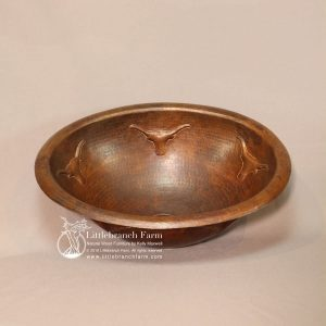 Hammered copper bathroom sink with long horns