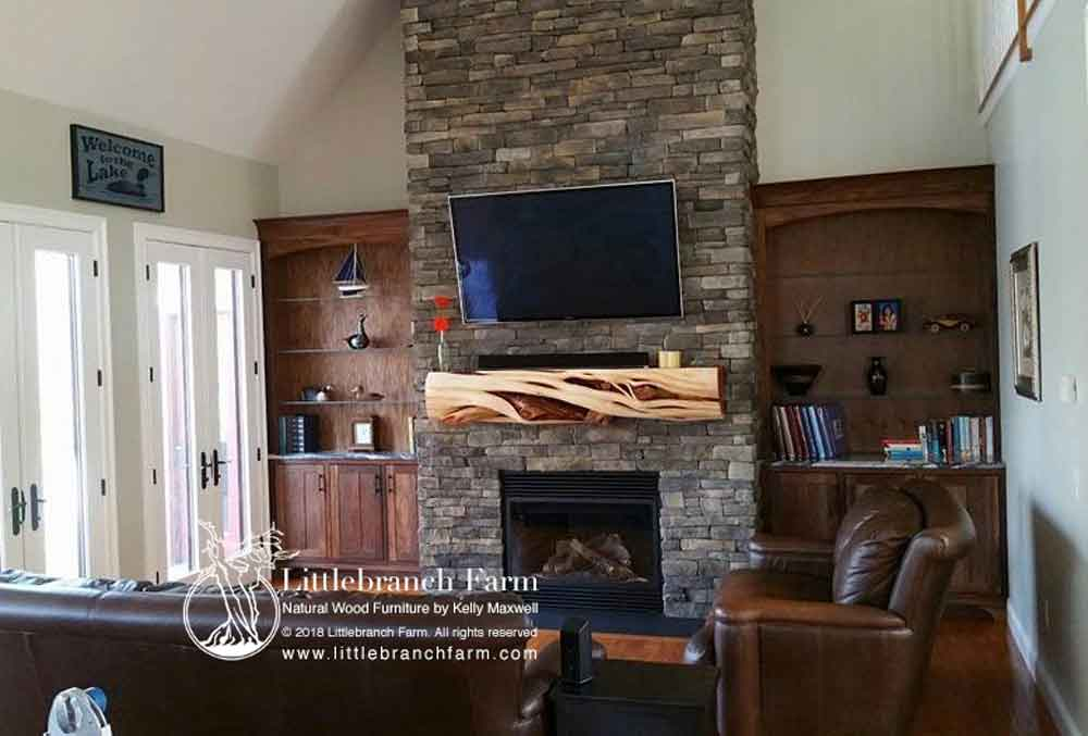 Living room fireplace with juniper log mantel